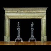 11724: A LARGE AND IMPOSING BOLECTION CHIMNEYPIECE IN IRISH CONNEMARA pale green figured marble. Supported on massive shaped jambs and lintel is a full- length barrel frieze under a sectioned moulded shelf.