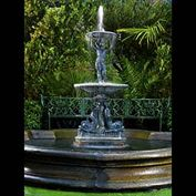 11901: ' SINGIN IN THE RAIN...'   A small Lead Fountain in the Italian Baroque manner, the central spout with two tiers below jointed by a putto support, and flanked on three sides by dolphin mounts terminat