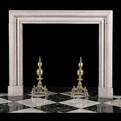 11991: A beige hard limestone bolection fireplace mantel. The stone is Portland stone showing small fossil formations and which has been polished. English early 20th century. .  Link to: Antique Baroque Chim