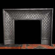 12069: A LOUIS XVI DECORATIVE CAST IRON FIREPLACE INSERT, with pretty floral motif detail. French mid to late 19th century.  Link to: Antique Fire grates and Register grates.