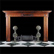 12555: ' SPLENDEO TRITUS ' .. A LATE NEO CLASSICAL CARVED WALNUT CHIMNEYPIECE in the manner of George III, very much inspired by Robert Adam. The centre tablet adorned with olive branches and the Latin motto