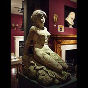 8078: BELLA DONNA..... A very attractive Vicenza stone hand carved figure of a Siren reclining on a rock. Italian 1930's.    Link to: Antique sculptures, carvings, plaques, tablets, coats of arms and panels