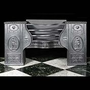 8551: A large cast iron hob grate in the style of Robert Adam. Made by the Carron foundry in Falkirk, Scotland.The Ancient Rome inspired decoration shows robed maidens tending incense burners, Mercurial mas