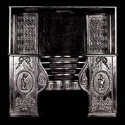 8579: One of a pair of Adam, Neoclassical hob grates (see 8578) with original fitted back and side plates with Roman Revival decoration and pierced bow ash pans. English, 19th century.  Link to: Antique Hob