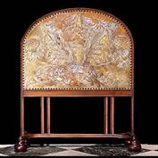 8686: An Arts & Crafts walnut & embossed leather firescreen in the manner of George Jack of Morris & Company, the screen depicting mythical dragons among foliage and thistles.   Link to:  Antique Firescreen
