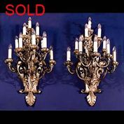 8778: A pair of very large Baroque 10 branch wall sconces in scrolled repousse metal. Italian, 1930's, ( photo before restoration, candles and bulbs to be replaced ).