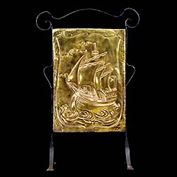 8916: A simple Arts and Crafts brass and iron firescreen decorated with a Galleon. circa 1920.  Link to:  Antique Firescreens.