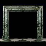 9017: A LARGE VERDE ANTICO MARBLE BOLECTION FIREPLACE of bold proportions with light green veining interspersing the darker green figuring. English 19th century. .  Link to: Antique Baroque Chimneypieces in