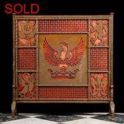 9027:  ' LIBERTY'S FIRESCREEN ':A very handsome wrought iron firescreen with stylised pierced decoration interspersed with mesh panels and backed in red velvet....to be replaced ?  The pierced decorati