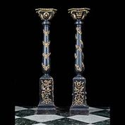 9347: A PAIR OF CARVED WOOD PEDESTALS IN THE BAROQUE MANNER, the ebonised baluster columns supporting carved capitals, with applied gesso decoration. Early 20th century.  Link to:  Antique Columns, Plinths,