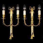 9697: A pairf two branch gilt bronze wall lights in the Louis XVI manner, composed of tasseled drapes topped by ribbon bows. Used replicas, 20th century. See also 9696.   Link to: Antique Wall Lights