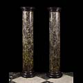 Antique green black marble columns plinths.