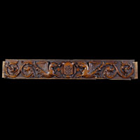 An antique Victorian carved oak panel