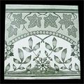 Antique green floral tiles.
