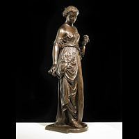 Antique bronze muse figure.