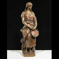 Bronze of a gypsy girl with tambourine.